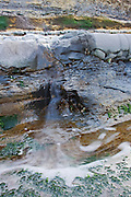 While looking around for photographic opportunities, before sunset arrived, I heard a trickling sound. After a bit of scanning, I noticed this mini-waterfall caused by the runoff from a rockpool a couple of levels up from the rockshelf I was on. I framed to include the fan-effect of the water in the next rockpool down.
