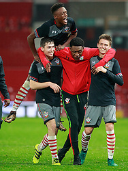 © Licensed to London News Pictures . 12/12/2016 . Manchester , UK . The Southampton Youth Team celebrate winning , after the final whistle . Manchester United vs Southampton FA Youth Cup Third Round match at Old Trafford . Photo credit : Joel Goodman/LNP