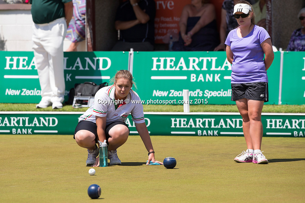 Burnside`s Mandy Boyd checks the bowls watched by Victoria`s Nicole Toomey in the women`s pairs final at the National Open Bowls Championship 2014, Browns Bay Auckland, New Zealand, Sunday, January 04, 2015. Photo: David Rowland/www.photosport.co.nz