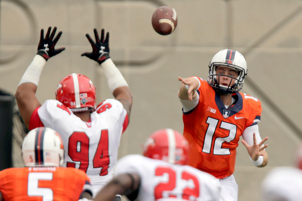 Illinois quarterback Wes Lunt (12) throws against Youngstown State during the first half of an NCAA college football game at Memorial Stadium Saturday, Aug. 30, 2014, on the University of Illinois campus in Champaign, Ill. (Lee News Service/ Stephen Haas)