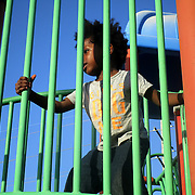 Miami's Little Haiti neighborhood resident Nathaniel Stenor two years old, enjoys the jungle gym at Range Park. Stenor, who was at that park with his mother, goes to the Park on the weekends.  (Photo by Norzilia Mezinord).
