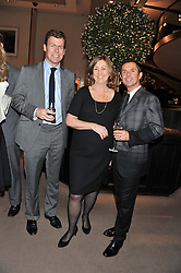 Left to right, PADDY BYNG, MD of Asprey, NICOLA NICHOLLS Chairman of The Woodland Trust and Jeweller SHAUN LEANE at a dinner hosted by Asprey for The Woodland Trust in support of the Jubilee Woods Project, held at Asprey, 167 New Bond Street, London on 22nd November 2012.
