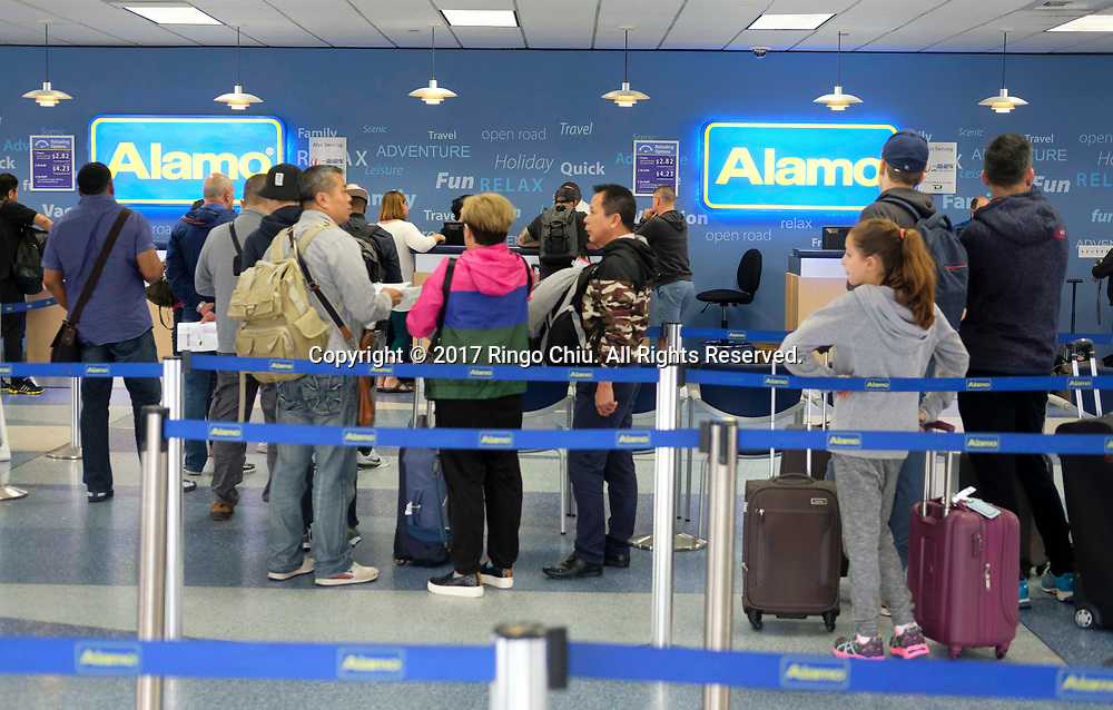 Customers at Alamo/National car rental facility in LAX. (Photo by Ringo Chiu)<br /> <br /> Usage Notes: This content is intended for editorial use only. For other uses, additional clearances may be required.