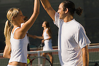 Mixed Doubles Partners High-Fiving Each Other