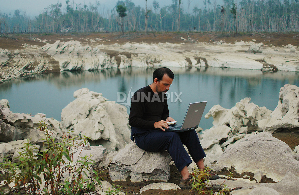 Population ecologist and Sangkulirang expedition coordinator Dr. Leo Salas analyzes data on the shores of Lake Tebo.