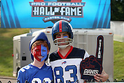 A pair of Buffalo Bills fans pose for a pre game photo before the 2014 NFL Pro Football Hall of Fame preseason football game against the New York Giants on Sunday, Aug. 3, 2014 in Canton, Ohio. The Giants won the game 17-13. ©Paul Anthony Spinelli