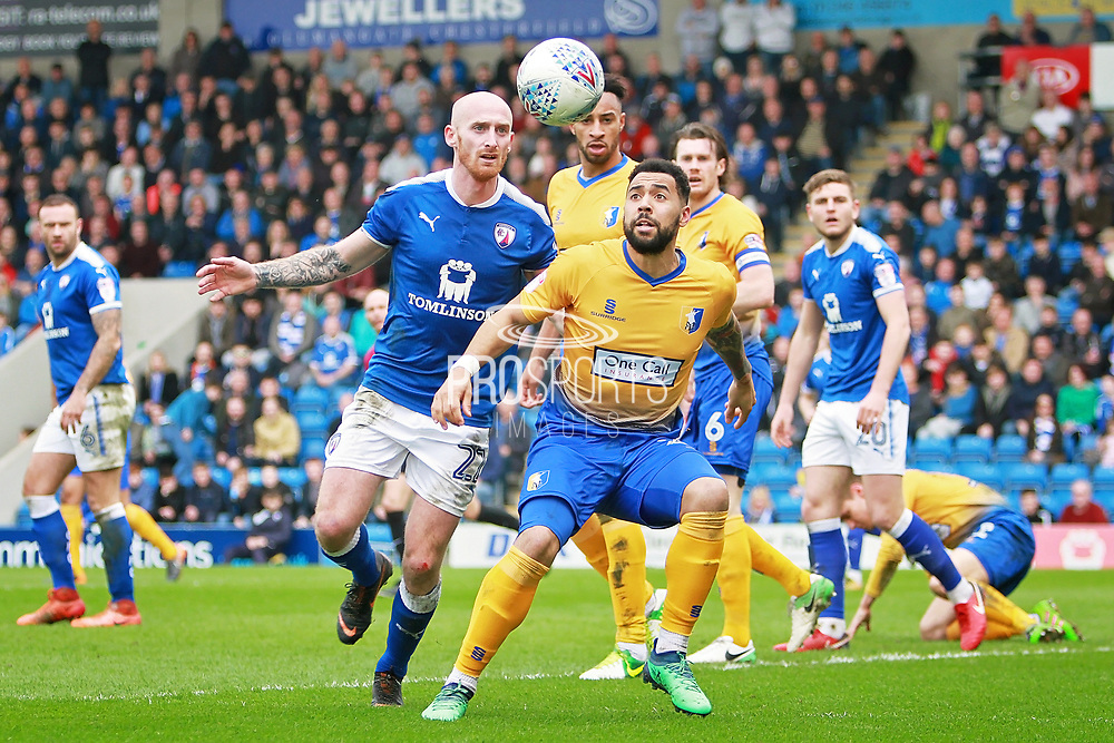Chesterfield defender Drew Talbot (22)  and Mansfield Town forward Kane Hemmings (23) early in the second half during the EFL Sky Bet League 2 match between Chesterfield and Mansfield Town at the Proact stadium, Chesterfield, England on 14 A pril 2018. Picture by Nigel Cole.