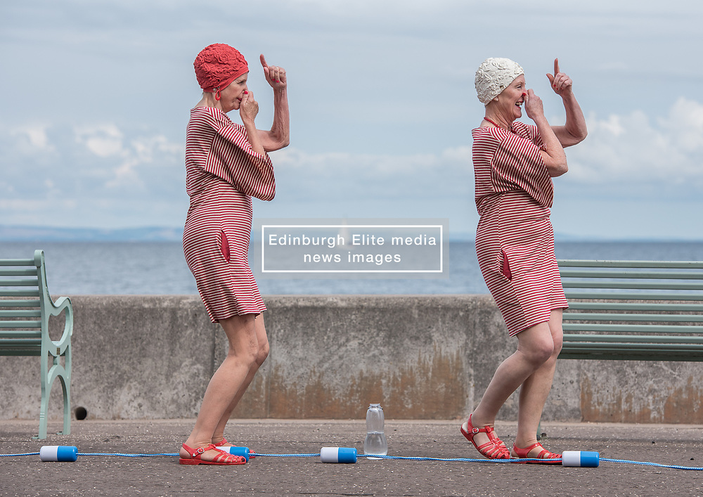 Inspired by Glasgow 2018 European Championships mascot Bonnie the Seal, the DanceBase Splashmob is a multi-generational dance ensemble which includes two Dance Base performance groups: Lothian Youth Dance Company, and the critically acclaimed semi-professional elder dancers company, PRIME. This lunchtime they took their routine to Portobello Promenade in Edinburgh and entertained people passing by. Choreographer Bridie Gane with costumes by Jeanine Byrne.<br /> <br /> <br /> © Jon Davey/ EEm