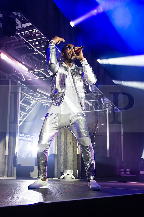 © Licensed to London News Pictures. 30/03/2014. London, UK.   Tinie Tempah performing live at The O2 Arena. Tinie Tempah is an English rapper real name Patrick Chukwuemeka Okogwu.  Photo credit : Richard Isaac/LNP