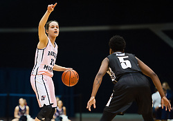 February 22 2016: Robert Morris Colonials guard Lou Mataly (12) calls out a play while being guarded by Long Island Blackbirds guard Shanovia Dove (5) during the first half in the NCAA Women's Basketball game between the Long Island Blackbirds and the Robert Morris Colonials at the Charles L. Sewall Center in Moon Township, Pennsylvania (Photo by Justin Berl)