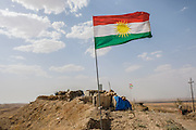 The Kurdish flag flies at the Mount Batiwa frontline, held and controlled by Peshmerga fighters. Iraqi Kurdistan.