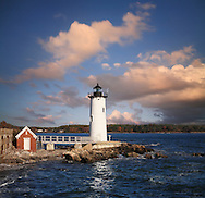 A Typically Artistic New England Cloudscape And Gorgeous Afternoon Light Over The Portsmouth Harbor Light, New Castle, New Hampshire, USA