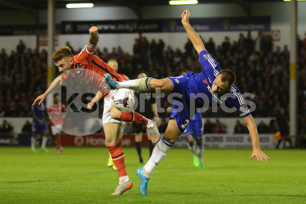 Walsall's Jason Demetriou challenges Chelsea captain John Terry for an aerial ball during the Capital One Cup match between Walsall and Chelsea at the Banks's Stadium, Walsall, England on 23 September 2015. Photo by Garry Griffiths.