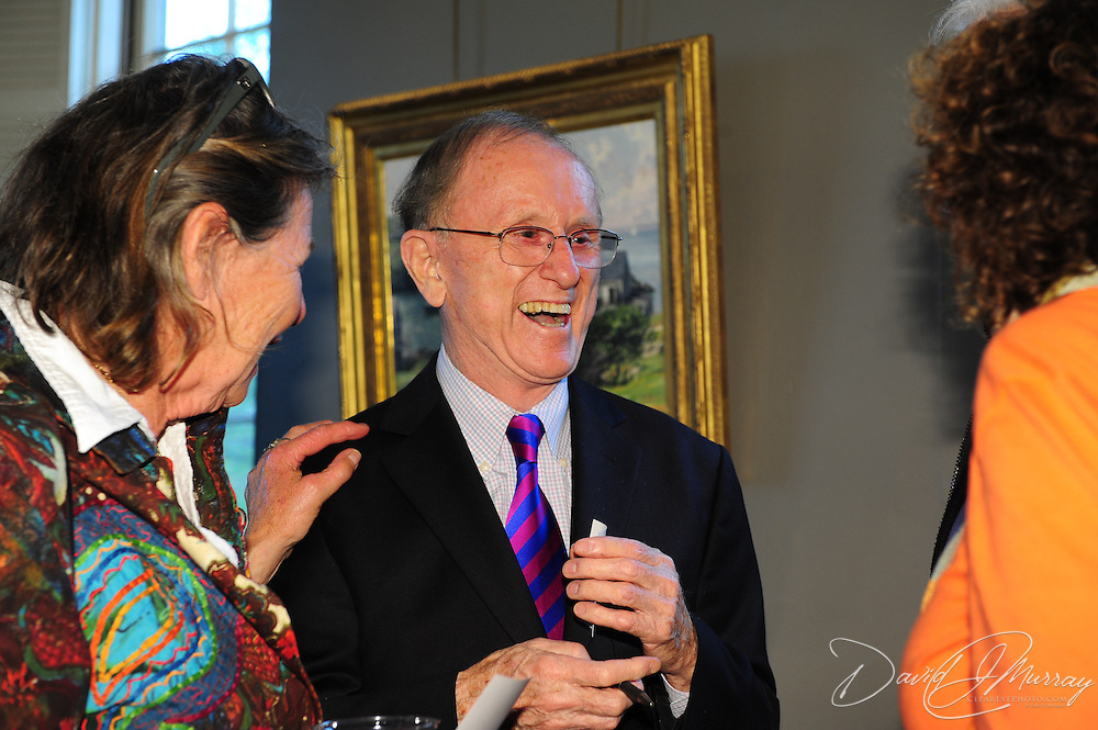 Artist John Stobart visits with guests/fans during a reception for the opening of an exhibit of 6 new paintings by him at The Discover Center in Portsmouth, NH. June, 2012