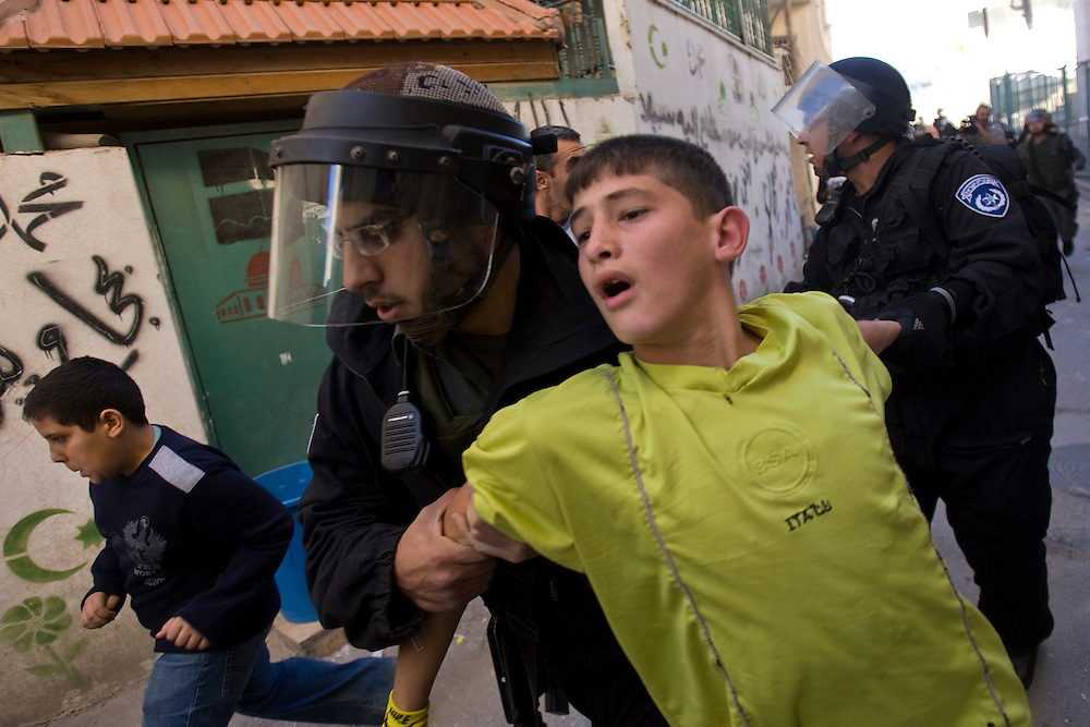 Jerusalem, Israel, 26.12.10...sraeli police detain 12-year-old Palestinian Ahmad Daana on suspicion of throwing stones during clashes in the East Jerusalem neighbourhood of Silwan December 26, 2010...Photo by Olivier Fitoussi