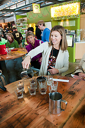 California: Napa City, Oxbow Market, Andrea Nadel of Gourmet Walks pours coffee from Ritual Coffee.   Photo copyright Lee Foster.  Photo # canapa107107