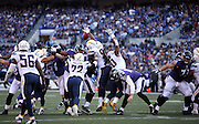 The San Diego Chargers leap and try to block a field goal attempt during the NFL week 13 regular season football game against the Baltimore Ravens on Sunday, Nov. 30, 2014 in Baltimore. The Chargers won the game 34-33. ©Paul Anthony Spinelli