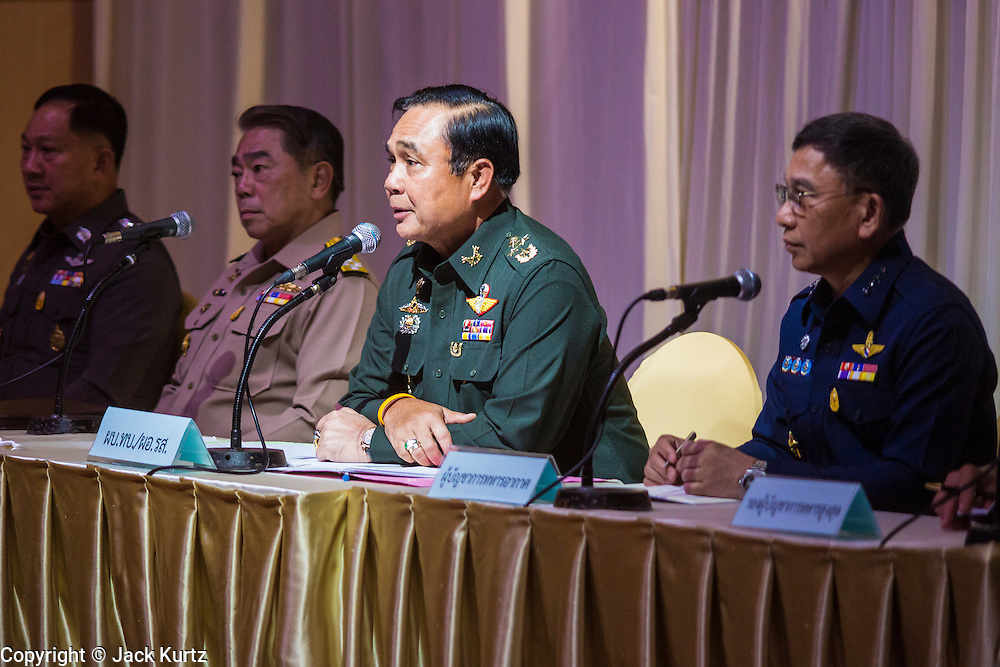 """20 MAY 2104 - BANGKOK, THAILAND: General PRAYUTH CHAN-OCHA, Commander-in-Chief of the Royal Thai Army, (center, at microphone) tells members of Thai society about martial law during a meeting at the Army Club in Bangkok. The Thai Army declared martial law throughout Thailand in response to growing political tensions between anti-government protests led by Suthep Thaugsuban and pro-government protests led by the """"Red Shirts"""" who support ousted Prime Minister Yingluck Shinawatra. Despite the declaration of martial law, daily life went on in Bangkok in a normal fashion. There were small isolated protests against martial law, which some Thais called a coup, but there was no violence.   PHOTO BY JACK KURTZ"""