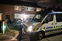 © Licensed to London News Pictures .  24/01/2018 . Manchester , UK . Police outside a house (pictured with white door and cars on driveway) on Somerton Avenue in Wythenshawe where on the afternoon of Sunday 21 January 2018 police report being called by the ambulance service to reports that a 22-month-old girl was having a medical episode . This evening (January 24 2018) police have arrested a 34-year-old woman and a 28-year-old man on suspicion of murder in relation to the girl's death . Photo credit : Joel Goodman/LNP