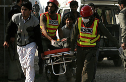 Rescuers transfer an injured man from the suicide blast site in northwest Pakistan's Peshawar on Feb. 13, 2015. At least 19 people were killed and over 40 others injured in a twin suicide attack at a mosque of Shia Muslims in Pakistan's northwestern provincial capital of Peshawar Friday afternoon, officials said. EXPA Pictures © 2015, PhotoCredit: EXPA/ Photoshot/ Ahmad Sidique<br /> <br /> *****ATTENTION - for AUT, SLO, CRO, SRB, BIH, MAZ only*****