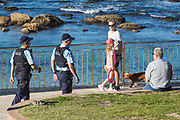Sydney, Australia. Saturday 25th April 2020. Bronte Beach in Sydney's eastern suburbs is closed due to the COVIC-19 pandemic. Police moving on locals sitting down which is not allowed. Credit Paul Lovelace/Alamy Live News
