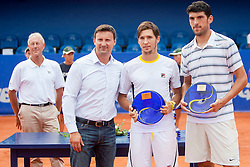 Vanja Bozickovic, tournament director, Dusan Lajovic of Serbia and Franko Skugor of Croatia during flower ceremony after final of doubles at 25th Vegeta Croatia Open Umag, on July 27, 2014, in Stella Maris, Umag, Croatia. Photo by Urban Urbanc / Sportida