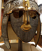 Replica of the Sutton Hoo helmet. Produced in the 1970's by the Royal Armouries. Features decorated panels as the original would have, before it corroded.