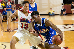 Kentucky Boys All-Star Quentin Goodin, right drives past Indiana Boys All-Star Desmond Bane in the first half. The Kentucky vs. Indiana All-Star Classic was held, Sunday, June 12, 2016 at Bellarmine University's Knights Hall in Louisville.