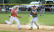 LOWER SOUTHAMPTON, PA - JULY 12:  Northampton's Anthony Zupito tries to get back to first base before being tagged out by Bensalem's Chris Kilcoyne at Kopper Kettle Field July 12, 2014 in Lower Southampton, Pennsylvania.  (Photo by William Thomas Cain/Cain Images)