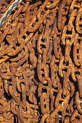 Rusty chain on quayside