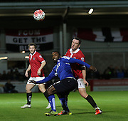 FC United's Sam Sheridan battles with Slyan Ebanks-Blake during the The FA Cup match between FC United of Manchester and Chesterfield at Broadhurst Park, Manchester, United Kingdom on 9 November 2015. Photo by Pete Burns.