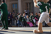 Rufus waves to kids during the homecoming parade.