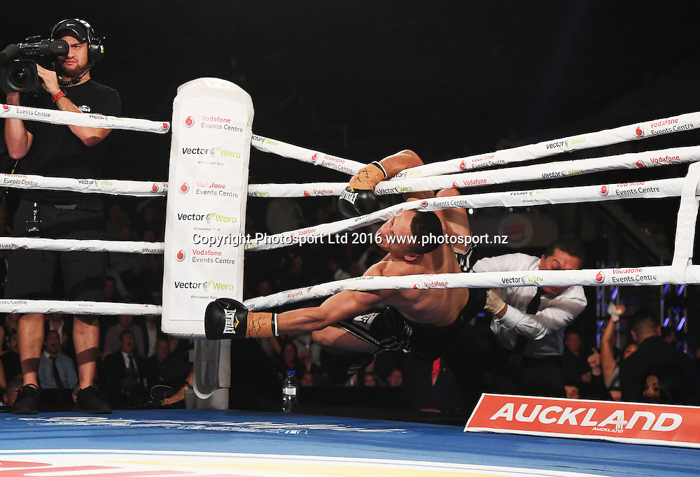 Jordan Tai falls through the ropes as he celebrates knocking down Joe Blackbourn. Undercard. Burger King Road to the Title by Duco Boxing. Saturday 21 May 2016. Vodafone Events Centre, Auckland, New Zealand. © Copyright Photo: Andrew Cornaga / www.photosport.nz