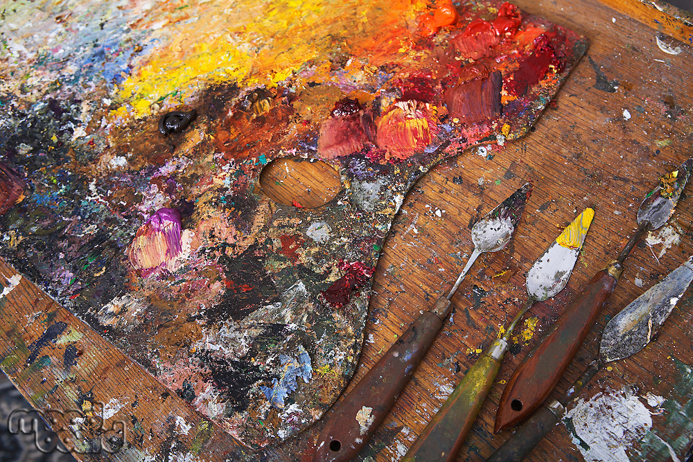 Artist's Palette and Palette Knives Covered in Paint