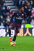 Ainsley Maitland-Niles of Arsenal (15) puts his foot on the ball during the Premier League match between Huddersfield Town and Arsenal at the John Smiths Stadium, Huddersfield, England on 9 February 2019.