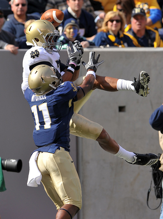 Navy Midshipmen cornerback Kwesi Mitchell (11) breaks up a pass intended for wide receiver TJ Jones (7)