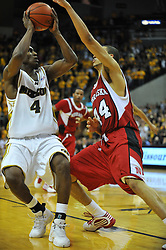 Jan 23, 2010; Columbia, MO, USA; Missouri Tigers guard J.T. Tiller (4) goes up for a shot as Nebraska Cornhuskers guard Ryan Anderson (44) attempts to block in the second half at Mizzou Arena in Columbia, MO. Missouri won 70-53. Mandatory Credit: Denny Medley-US PRESSWIRE