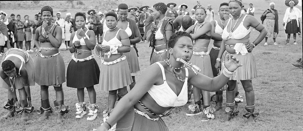 Msinga Top, Msinga, KwaZulu Natal, South Africa, December 1998. A dance group in Msinga, KwaZulu-Natal prepare to perform at a young girl's coming of age, or memulo, KwaZulu-Natal, South Africa