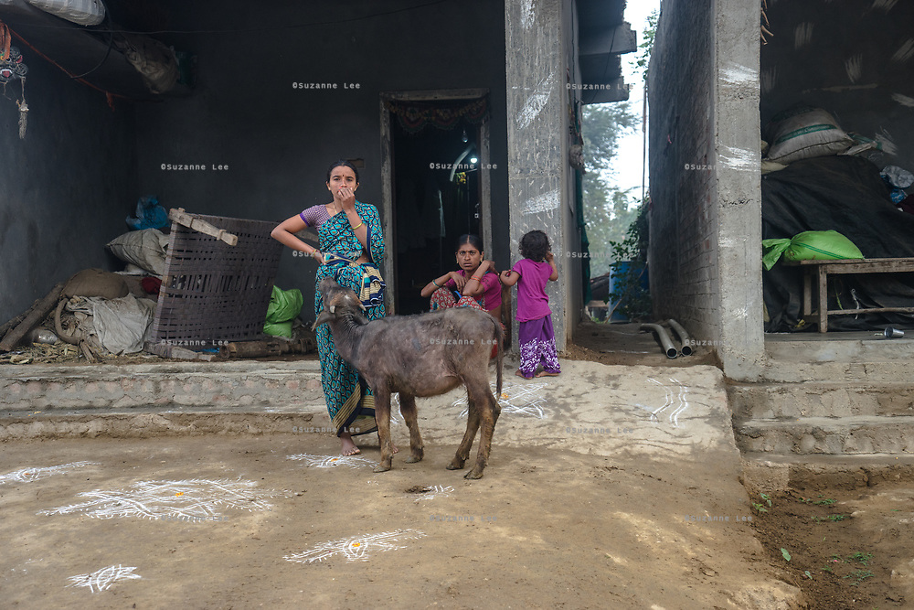 People stand outside a house in village Gorikothapally, Telangana, Indiia, on Friday, February 8, 2019. Photographer: Suzanne Lee for Safe Water Network