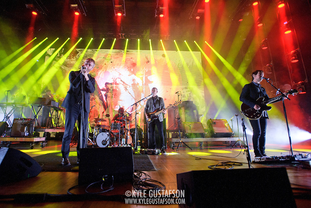 COLUMBIA, MD - June 6th,  2013 -   Matt Berninger, Bryan Devendorf, Scott Devendorf and Aaron Dessner of The National perform on a rainy night at Merriweather Post Pavilion in Columbia, MD.  The band just released their sixth studio album, Trouble Will Find Me, which debuted at No. 3 on both the US and UK album charts. (Photo by Kyle Gustafson/For The Washington Post)