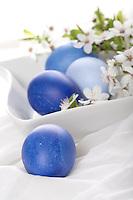 Blue easter eggs in bowl