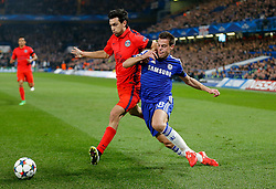Cesar Azpilicueta of Chelsea is challenged by Javier Pastore of Paris Saint-Germain - Photo mandatory by-line: Rogan Thomson/JMP - 07966 386802 - 11/03/2015 - SPORT - FOOTBALL - London, England - Stamford Bridge - Chelsea v Paris Saint-Germain - UEFA Champions League Round of 16 Second Leg.