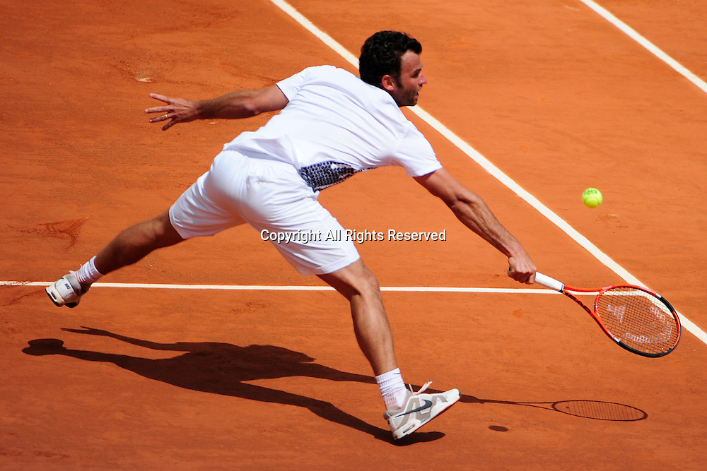 22.05.2011 French Open Tennis from Roland Garros Paris. Marc Gicquel of France returns a shot in his match against Albert Montanes of Spain on day one of the French Open tennis championships. The match was won by Montanes 6-4, 6-4, 6-2.