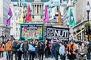 "The NUT leads a national strike action in England and Wales. Marches and rallies are being held around the country, including this one from Broadcasting House to Downing Street, Whitehall. The union says the action is being taken against: Excessive workload and bureaucratic; Performance related pay and in defence of a national pay scale system; Unfair pension changes. Christine Blower, General Secretary of the National Union of Teachers, the largest teachers' union said: ""Teachers deeply regret the disruption caused by this strike action to parents and teachers. The Government's refusal, however, to engage to resolve the dispute means that we have no alternative other than to demonstrate the seriousness of our concerns.<br /> ""Teachers' levels of workload are intolerable –the Government's own survey, published last month, shows that primary school teachers work nearly 60 hours a week and secondary school teachers work nearly 56 hours a week. 2 in 5 teachers are leaving the profession in the first 5 years of teaching as are many others.  This is bad for children and bad for education. London, UK 26 March 2014.<br />  Guy Bell, 07771 786236, guy@gbphotos.com"