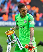 Ederson Moraes (31) of Manchester City with the FA Cup at full time during the The FA Cup Final match between Manchester City and Watford at Wembley Stadium, London, England on 18 May 2019.