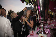 amanda Ellisach and Trinny Woodall, The Summer Party sponsored by Yves St. Laurent. Serpentine Gallery. 11 July 2006. . ONE TIME USE ONLY - DO NOT ARCHIVE  © Copyright Photograph by Dafydd Jones 66 Stockwell Park Rd. London SW9 0DA Tel 020 7733 0108 www.dafjones.com