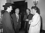 U2 Meet An Taoiseach, Charles Haughey.    (R58)..1987..18.05.1987..05.18.1987..18th May 1987..After their highly successful tour of America, An Taoiseach, Charles Haughey welcomed U2 back to Ireland with a reception held in Iveagh House, Dublin. Iveagh House formerly a home to the Guinness family is now held by the Department of Foreign Affairs...An Taoiseach,Charles Haughey, introduces Eimear to The Edge and Bono at the reception.