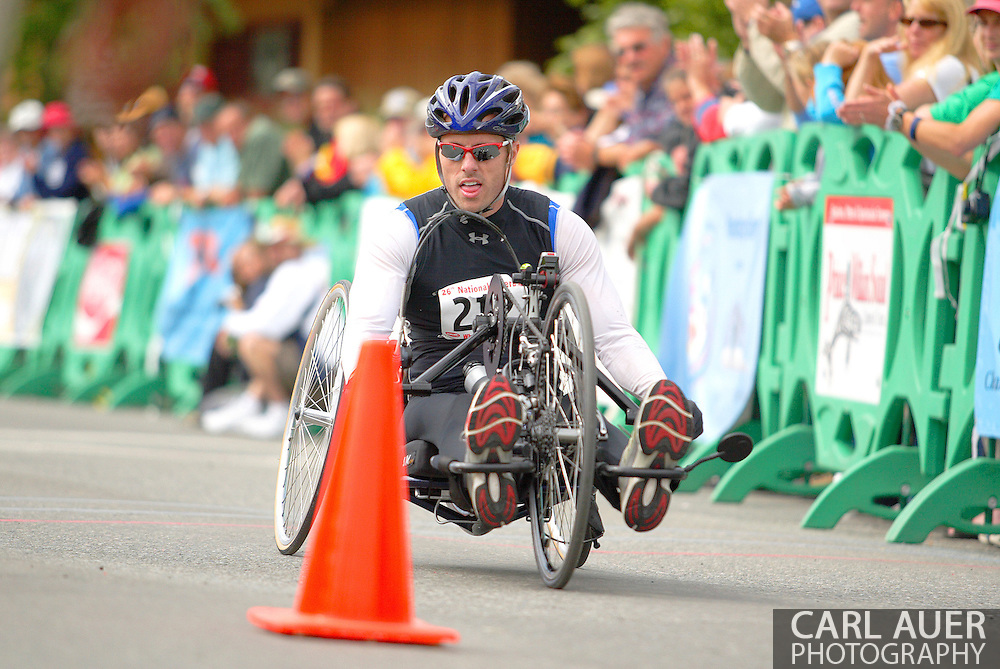 July 4th, 2006:  Anchorage, Alaska - David Randall (212), coasts across the finish line of the 5k handcycle event at the 26th National Veterans Wheelchair Games..