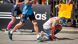 2014 Boston Marathon: runner drops to pavement