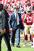 Nov 25, 2018; Tampa, FL, USA; San Francisco 49ers general manager John Lynch smiles and walks the field before his team plays an NFL game against the Tampa Bay Buccaneers at Raymond James Stadium. The Buccaneers beat the 49ers 27-9. (Steve Jacobson/Image of Sport)